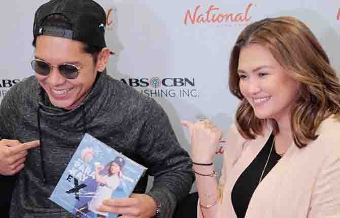 Carlo Aquino surprises Angelica Panganiban during book launch