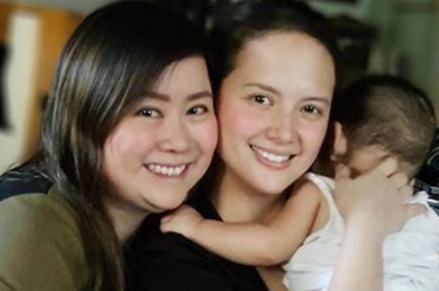 Ellen Adarna smiles for a photo op while holding a baby— is this her son Elias?