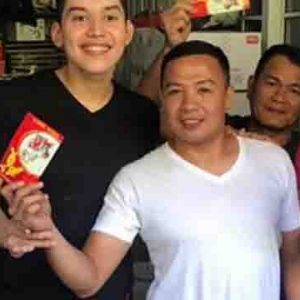 Kuya Joshua distributes 'ang pao' to members of household