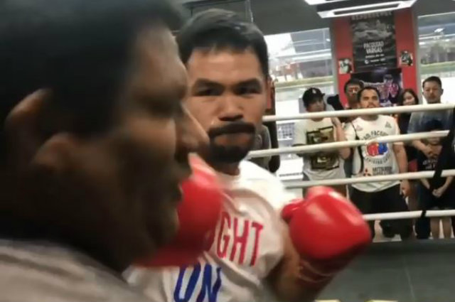 "Manny Pacquiao punches coach Buboy Fernandez in the face while training: ""Thought you were Broner"""