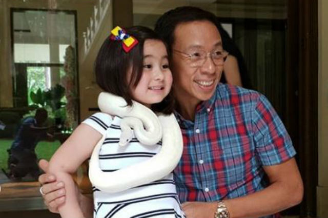 LOOK: Scarlet Snow receives a python from Kuya Kim Atienza