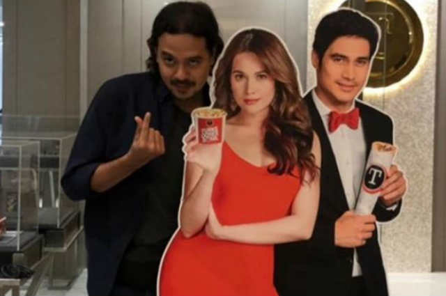LOOK: John Lloyd Cruz flashes 'finger heart' with Bea Alonzo and Piolo Pascual's standee