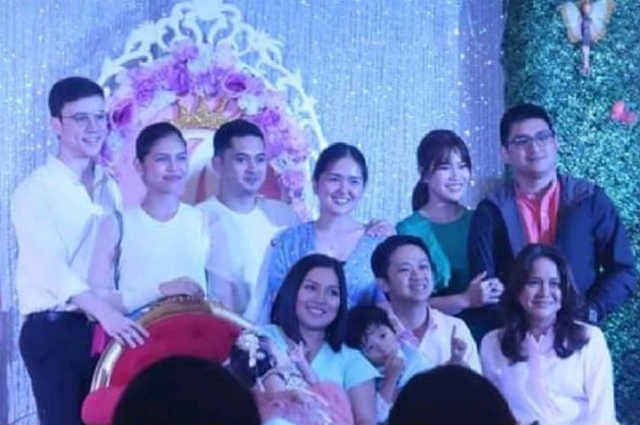 Arjo Atayde poses with Maine Mendoza and family at her niece's birthday party